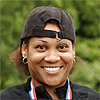 Smiling woman wearing a backwards baseball cap
