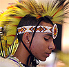 Young man wearing the traditional pecha, a mohawk-like headdress of a fancy dancer