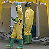Two workers in yellow safety suits