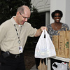 NIEHS Health Scientist Administrator Mike Humble, Ph.D. places a bag of food at a food drive drop-off point