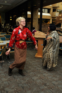 Dona McNeill and Bono Sen, Ph.D. join in a spontaneous dance