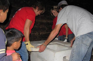 Mission Guatemala volunteers assembling a stove