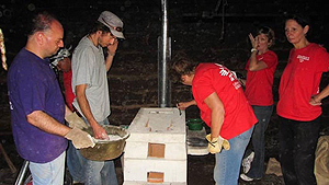 Mission Guatemala volunteers venting and sealing a stove