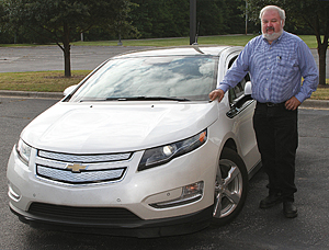 Richard Cregar with electric car