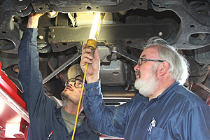 Richard Cregar teaching an automotive technician
