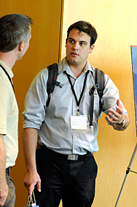 Andres Larrea, Ph.D., with a career fair attendee