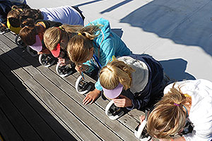 Children using microscopes on the Learning Barge