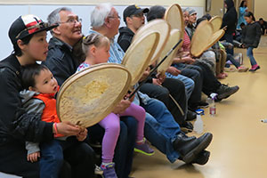 Savoonga residents play drums