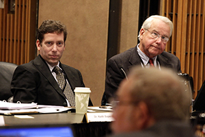 Carney sitting at a table during a meeting