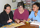 Hricko, center, is shown working with staff from the Long Beach Alliance for Children with Asthma