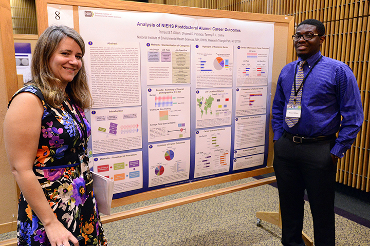 Gilliam and Collins presenting a poster