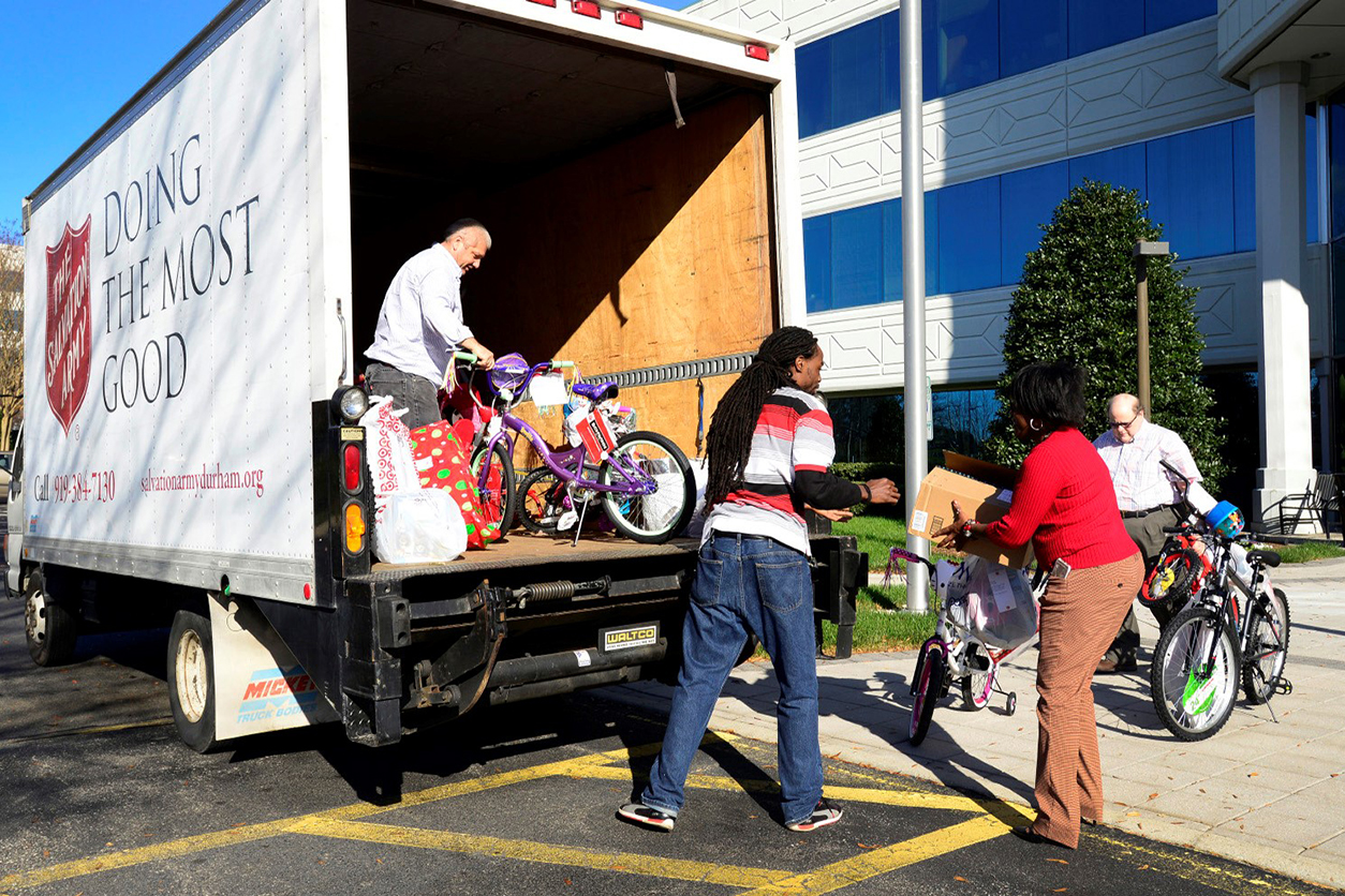 Placing toys on the Salvation army truck