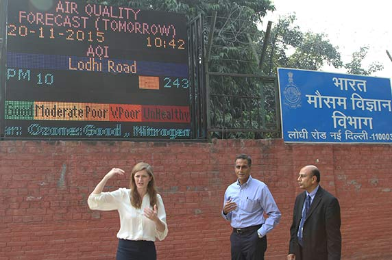 Power, Verma, and Nadadur waking past the digital air quality sign