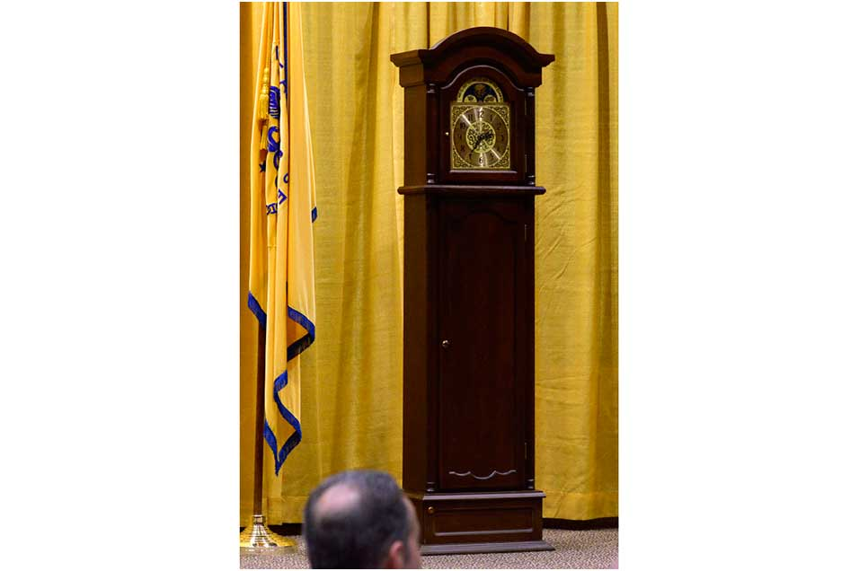 Grandfather clock standing on stage