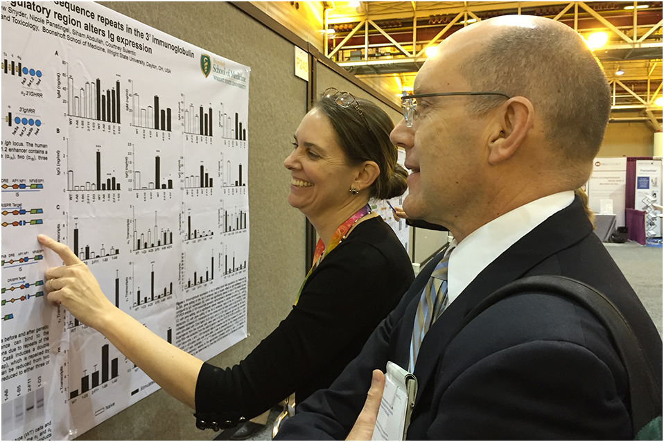 Michael Humble, Ph.D. viewing posters