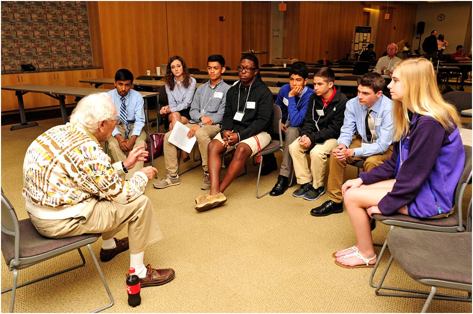 Oliver Smithies, D.Phil. speaks with a group of local high schoolers