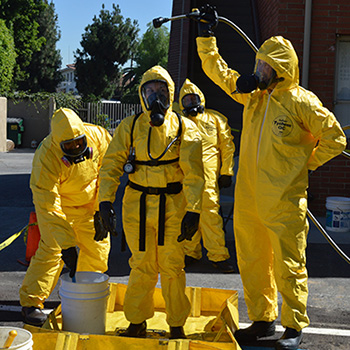 Group of people in hazmat suits
