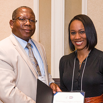 McWhorter, right, accepted her award from Lincoln Edwards, D.D.S., Ph.D., president of Northern Caribbean University and chair of the NMRI planning committee.