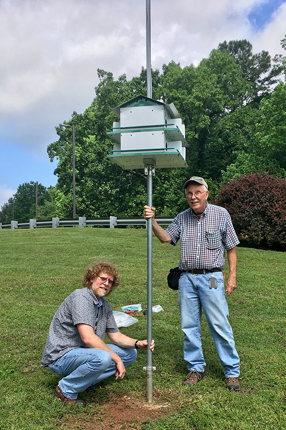Steinmetz and Willis reinstalled a purple martin house that was upgraded to better withstand wind. Purple martins are one of the topics addressed in the new Kids Pages.
