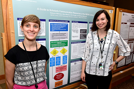 Even the library got into the act — Victoria Patterson, right, and Nora Weston described library support for researchers navigating the process of journal selection, internal review, and status tracking.