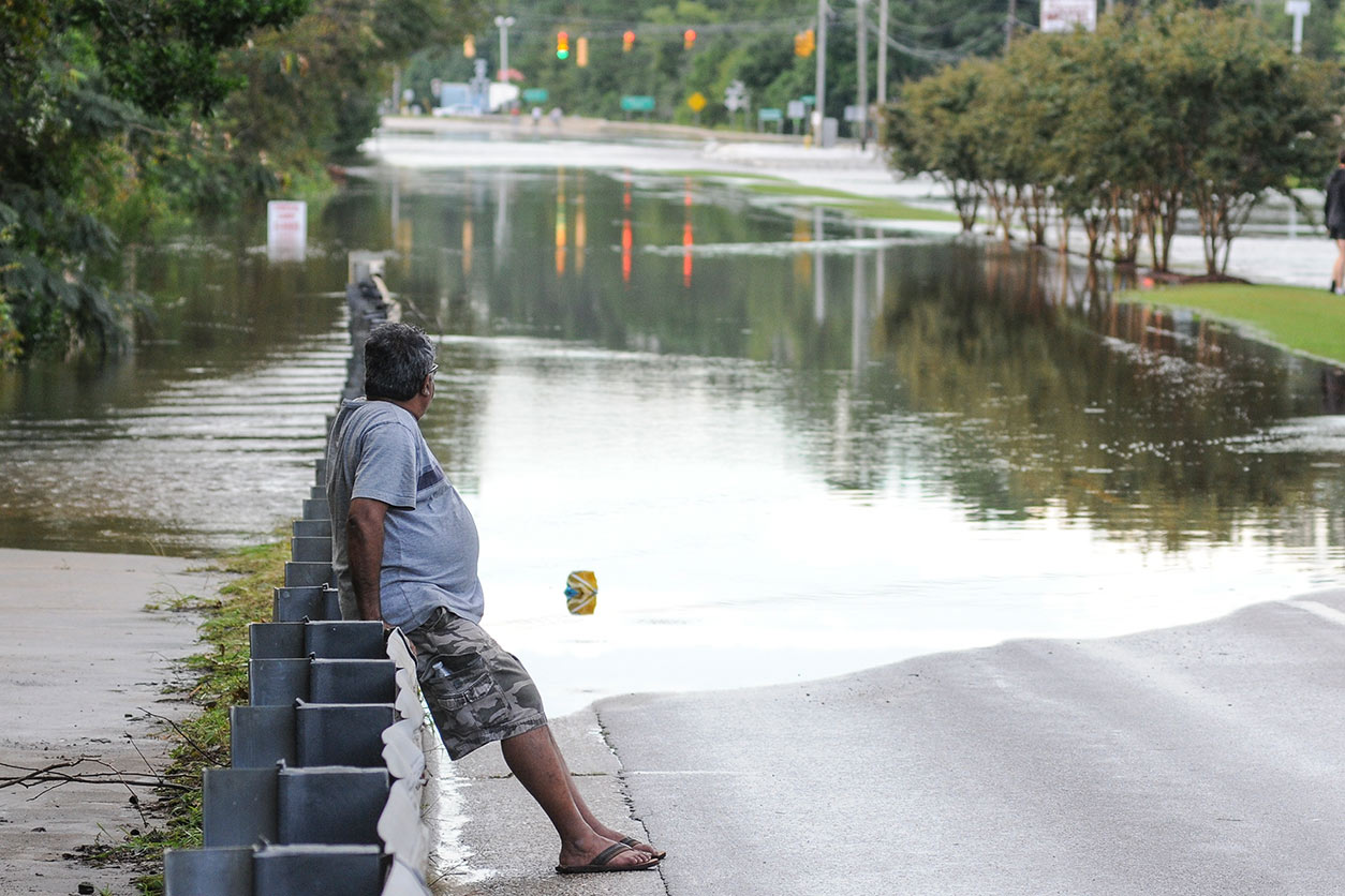 A resident of Wilmington, NC, surveys the flood waters following Hurricane Florence.