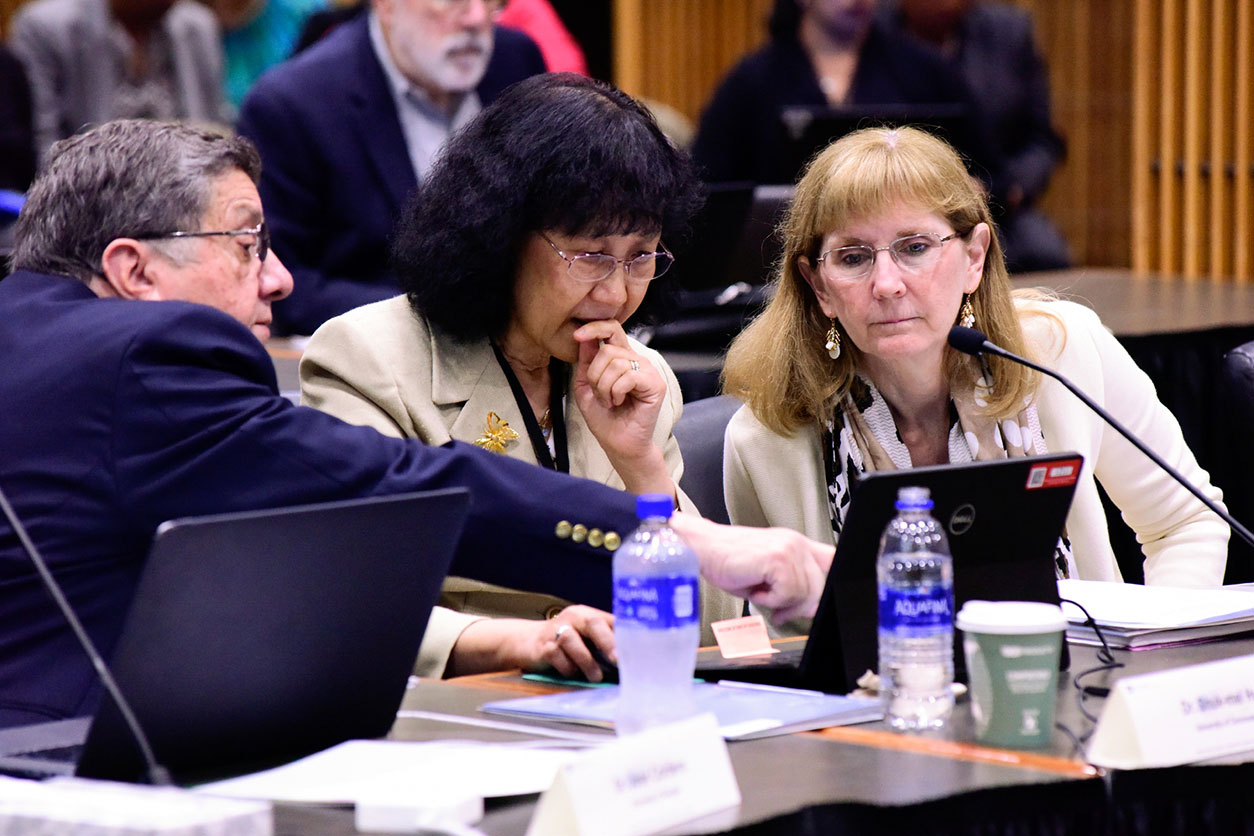 Cordero, Shuk-Mei and Schantz speak during the meeting
