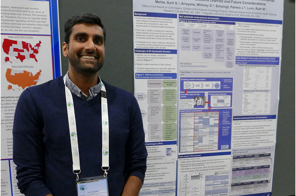 Suril Mehta stands next to the poster he presented