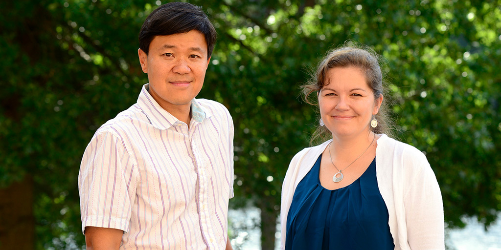 Yao and Nicol pose for a photograph outside of NIEHS