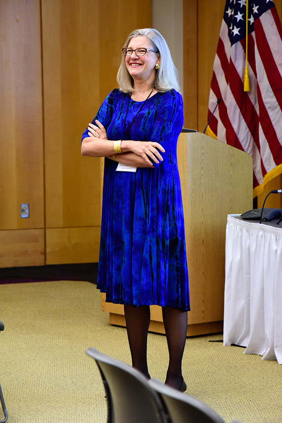 Cheryl Walker laughs during a talk