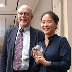 Suk Ph.D., left, presented the Wetterhahn Award to Kim