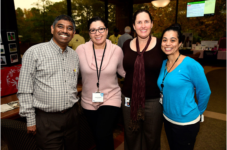 Charity fair attendees took a moment of cross-divisional fellowship
