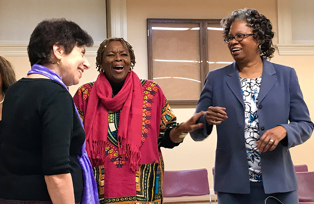 Linda Birnbaum laughs with Thelma Jones and Lucile Adams-Campbell
