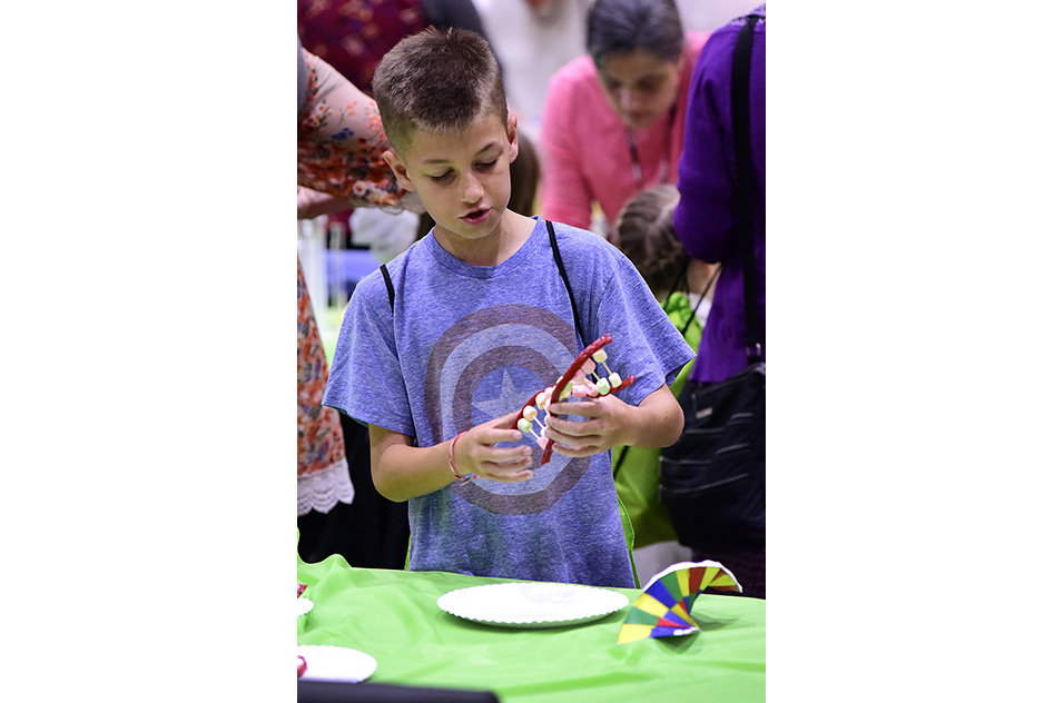 boy with hands-on DNA model