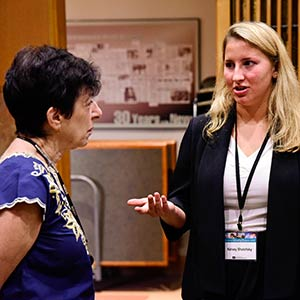 NIEHS and NTP Director Linda Birnbaum, Ph.D., left, listened as Kelsey Shelofsky