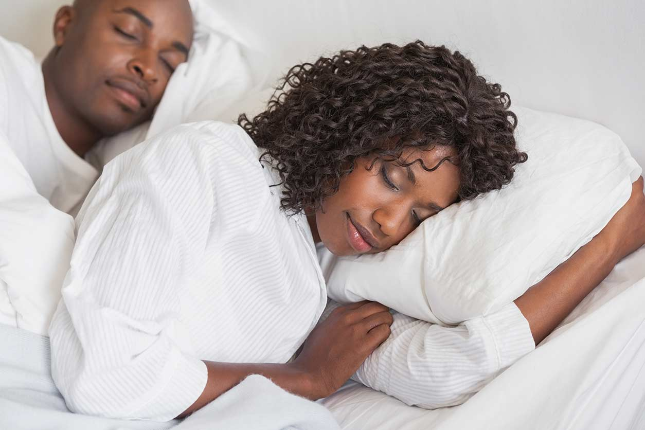 man and woman sleeping peacefully