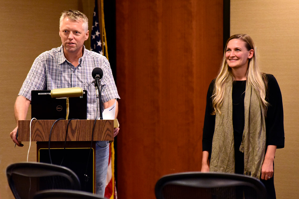 Thaddeus Schug, Ph.D. at a podium with Marissa Sobolewski, Ph.D.