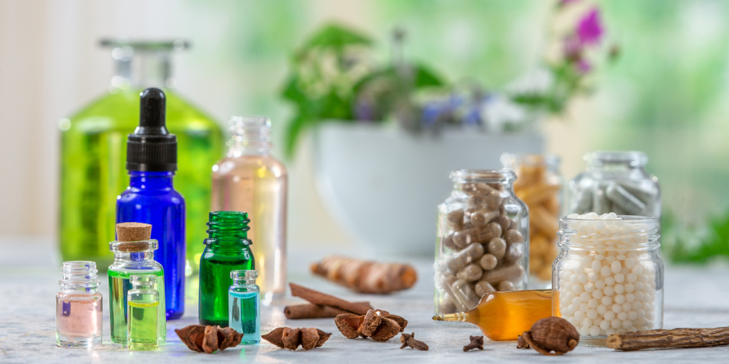Botanical dietary supplements and essential oils in glass jars