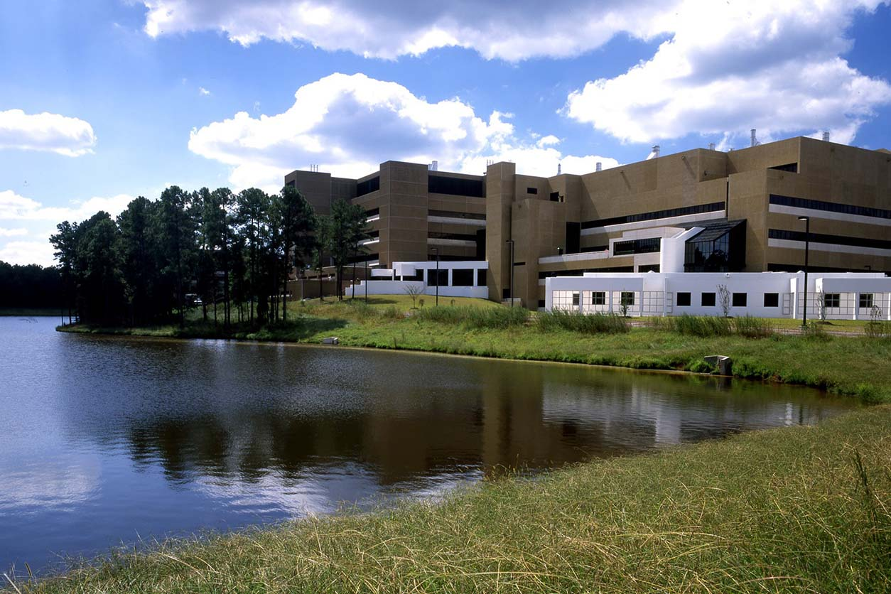 Side view of the NIEHS building adjacent to the lake