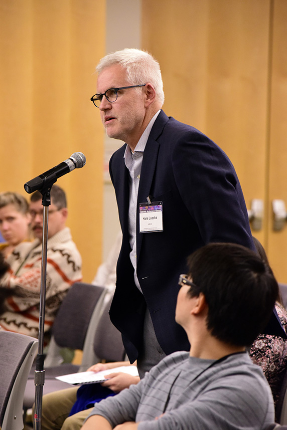 Hans Luecke, Ph.D., asking a question during the presentation