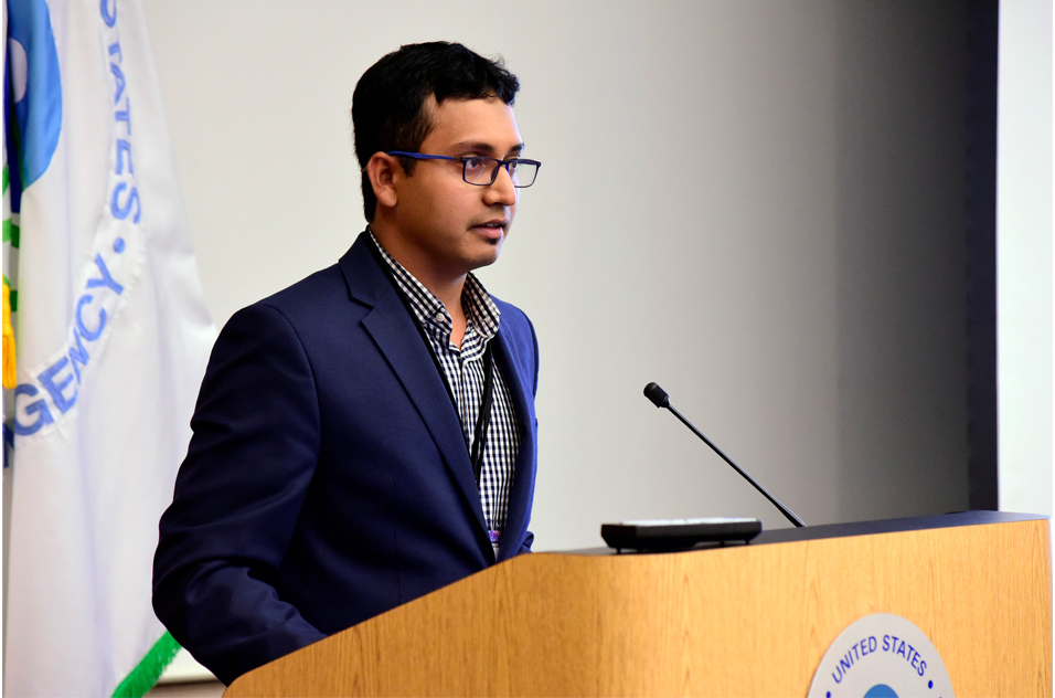Arif Rahman, Ph.D. stands at podium