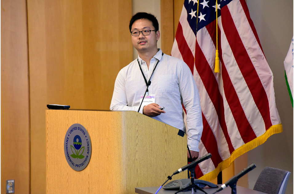 Zhixiong Zhou, Ph.D. stands at podium