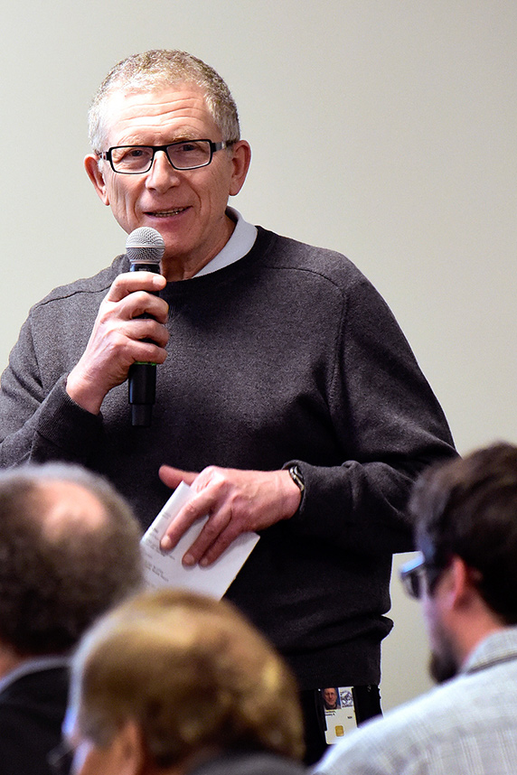 Dmitry Gordenin, Ph.D. holding microphone at NIEHS Distinguished Lecture Series