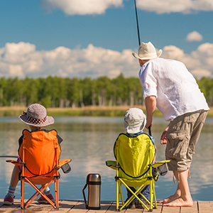 A family fishing on a dock