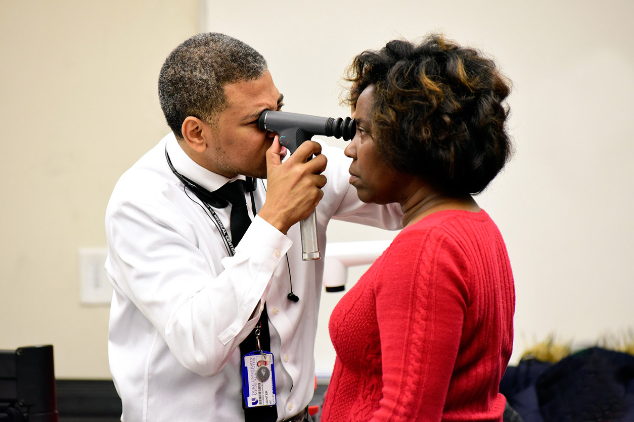 Thomas Hunter, M.D., Duke University Health System doing glaucoma check