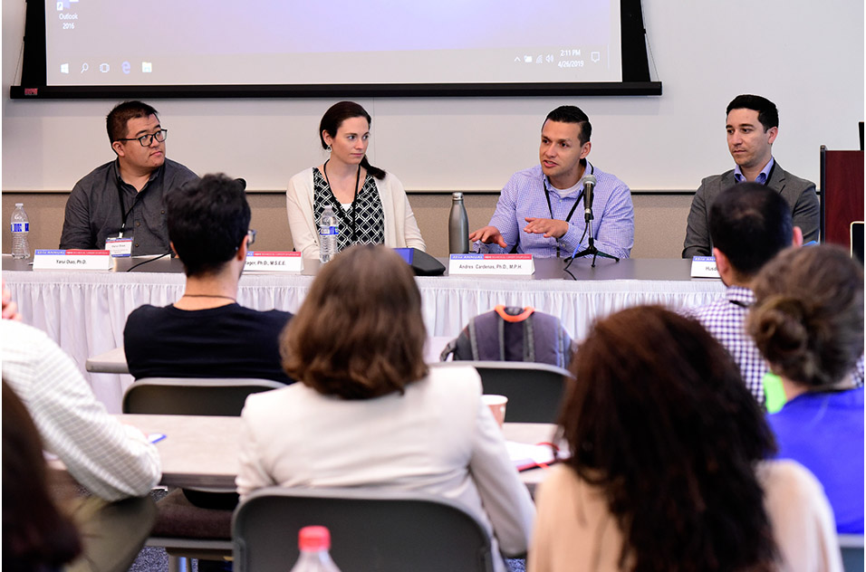 Faculty members speaking during a panel discussion