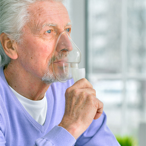 older person using an inhaler