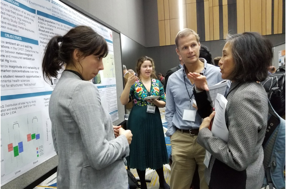 trainees talk during poster presentation
