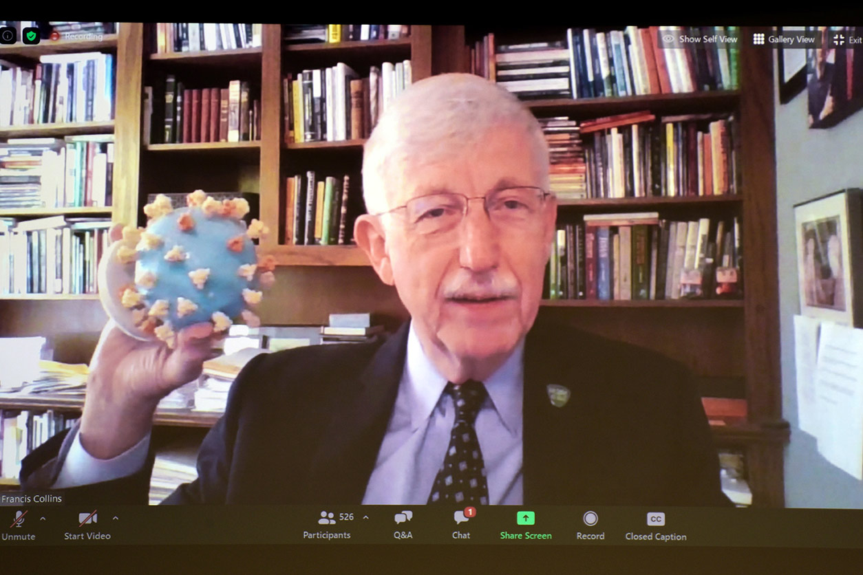 Francis Collins holds a model of SARS-CoV-2