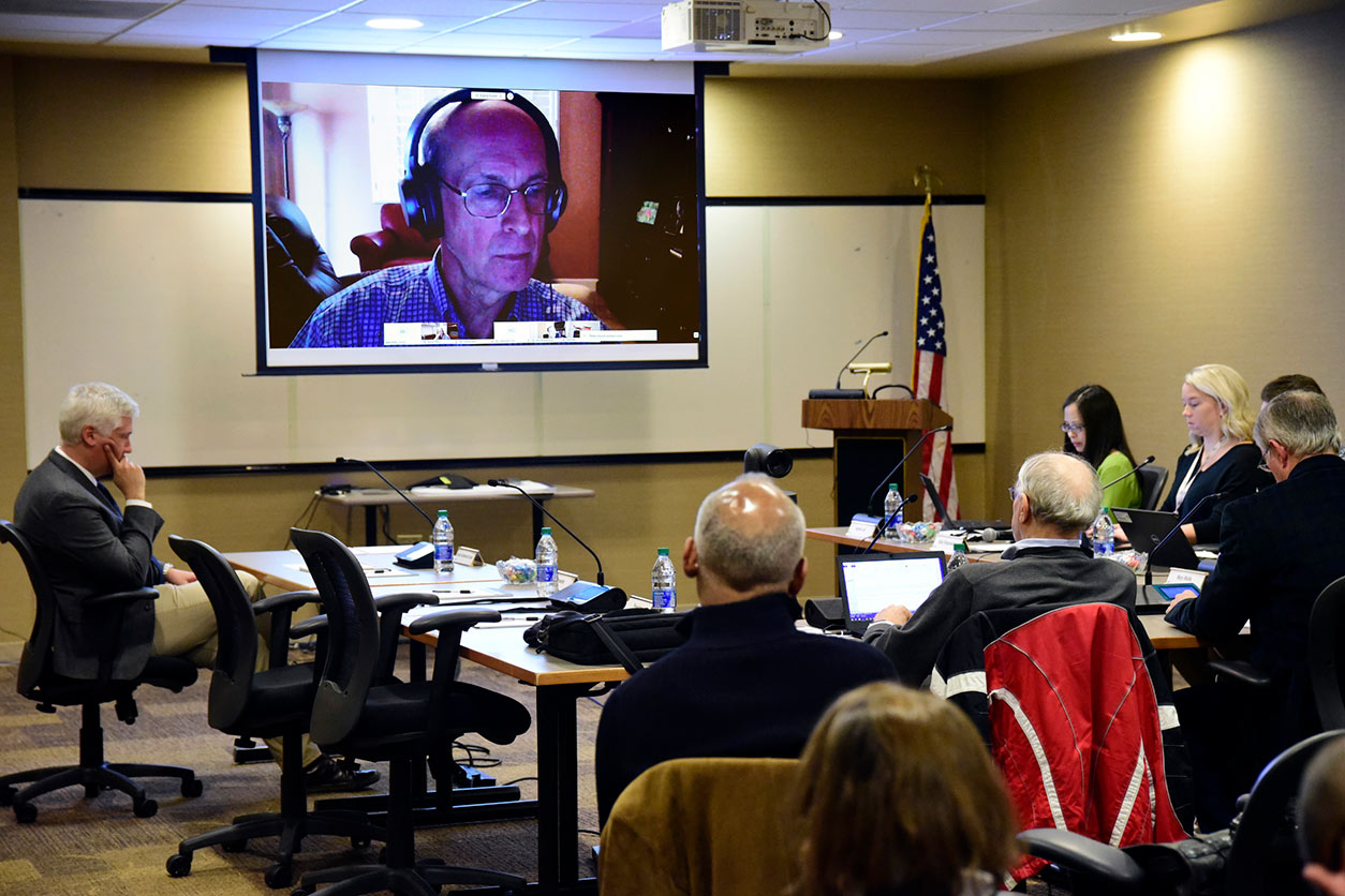 BSC Chair, David Eaton, Ph.D., on screen with seated audience in foreground