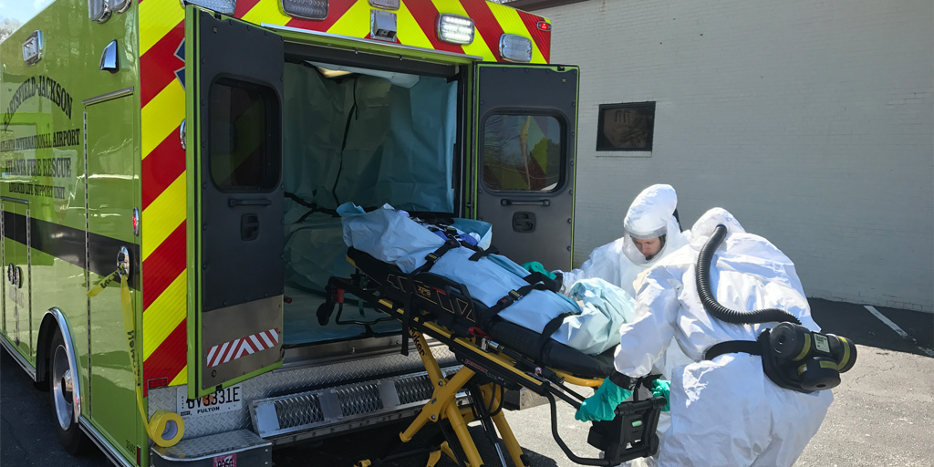 emergency medical responders receive training by an ambulance